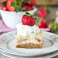 Strawberry Shortcake Cheesecake Bars. Golden Oreo crust, strawberries swirled in the cheesecake and an amazing streusel on top. Serve with strawberries and whipped cream!