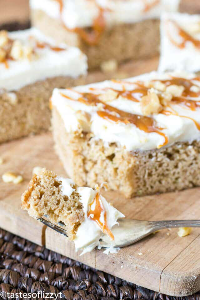 Use up garden zucchini in these simple 5 ingredient Frosted Caramel Zucchini Bars. The caramel cake mix matches perfectly with the cream cheese frosting.