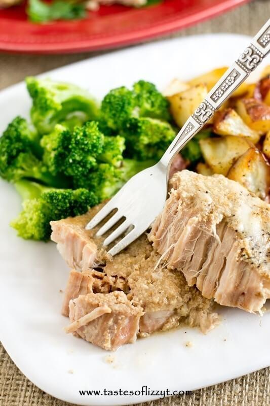 fork grabbing a bite of paleo slow cooker pork chops