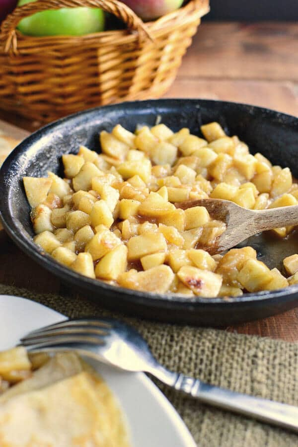 making homemade apple pie filling in a skillet