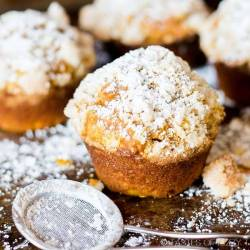 pumpkin spice muffins dusted with powdered sugar
