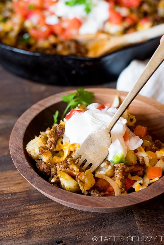Top golden brown potatoes with your favorite taco ingredients for gluten free skillet Mexican potatoes the family will love!