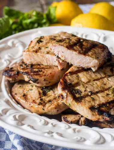 plate of grilled basil lemon pork chops