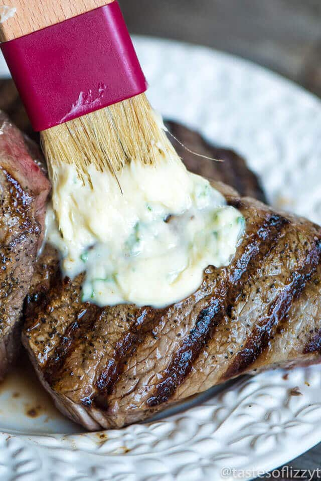 You've never had a steak like this! A homemade savory seasoned butter makes this Garlic Butter Steak melt in your mouth. Tips for grilling the best steak.