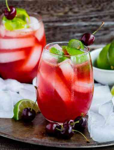 Homemade Cherry Limeade - How to make cherry limeade at home with REAL cherries and limes. The recipe makes delicious summer drink made with NO food coloring or fake ingredients.