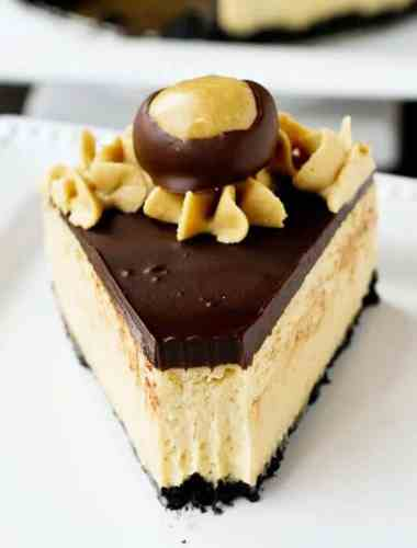 peanut butter buckeye cheesecake with oreo crumb crust and chocolate ganache