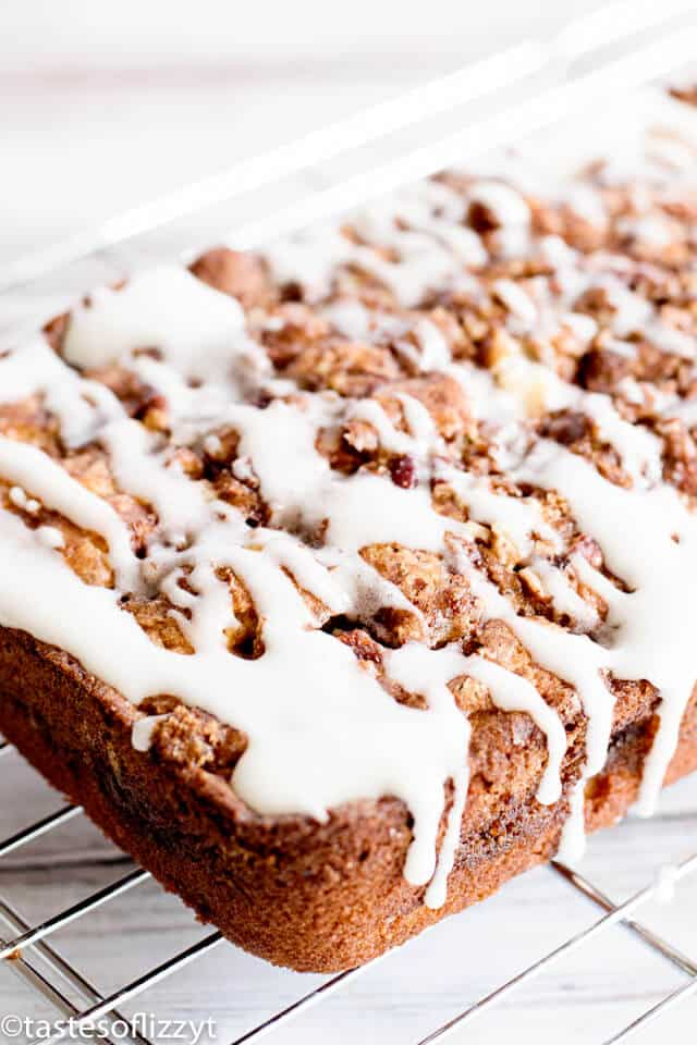 loaf of apple fritter bread with cinnamon streusel glaze