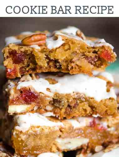 These chewy Fruit Cake Cookie Bars will melt in your mouth. This Christmas dessert with pecans, dried cherries and pineapple has a rum glaze.