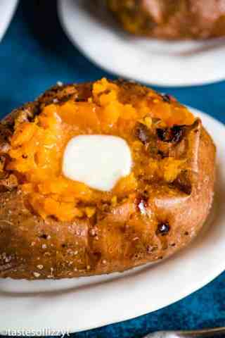 baked sweet potato with butter sitting on a plate
