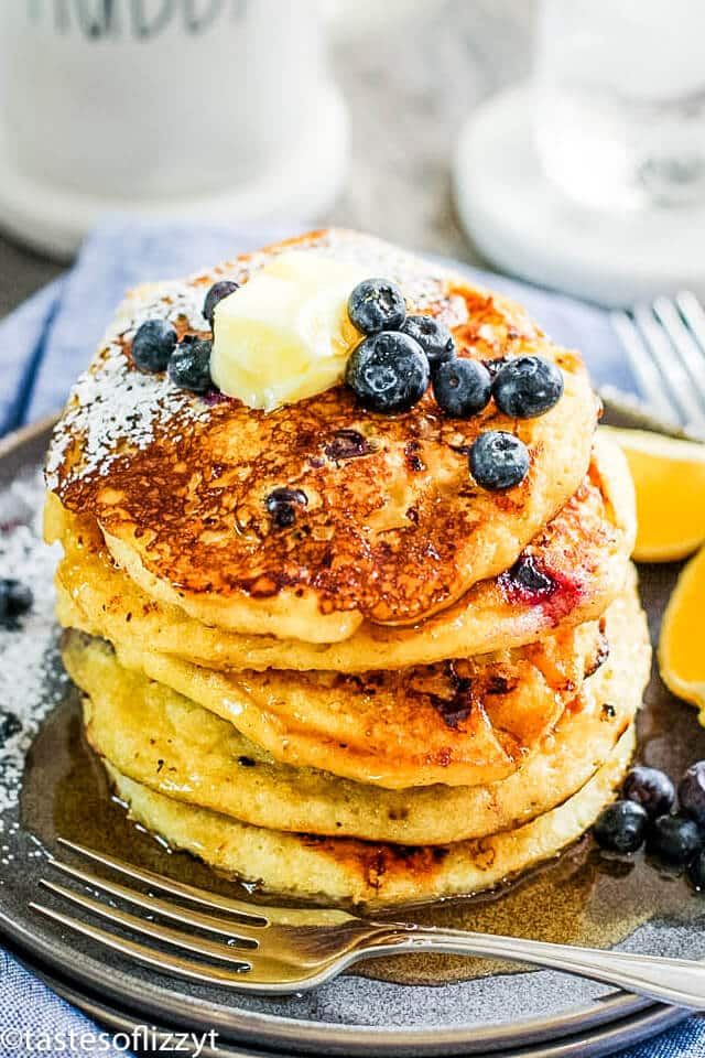 stack of cottage cheese pancakes with blueberries and syrup