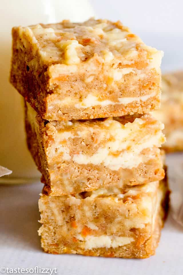 a stack of carrot cake bars with cheesecake swirl