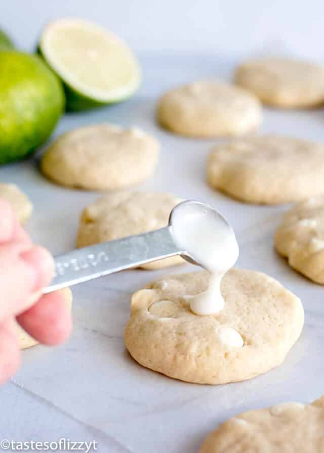 adding lime glaze to the top of key lime sugar cookies