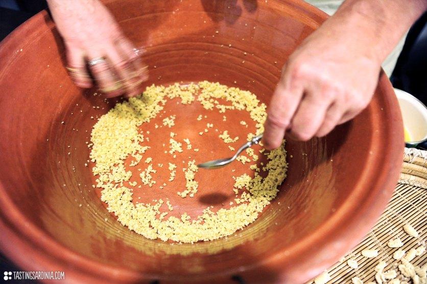 making fregola pasta, a Sardinian cous-cous like pasta