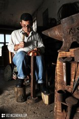 coppersmith Luigi Pitzalis working in his own workshop
