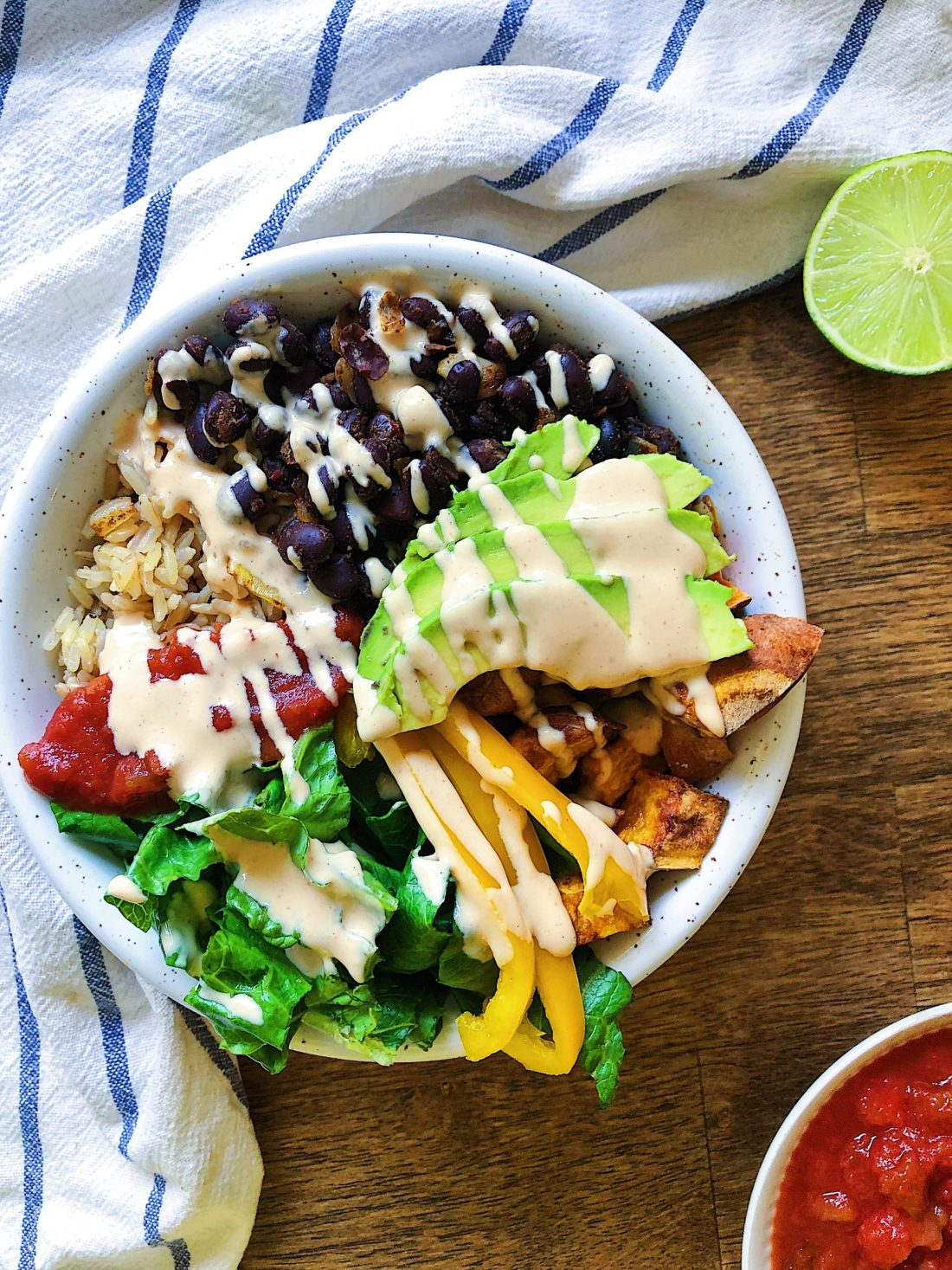 Vegan burrito bowl with spicy lime sauce