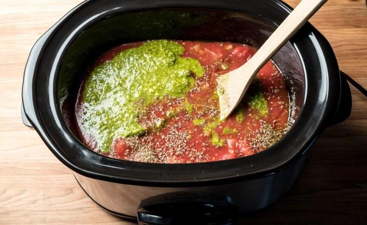 Stock pot of Creamy tomato basil soup with parmesan