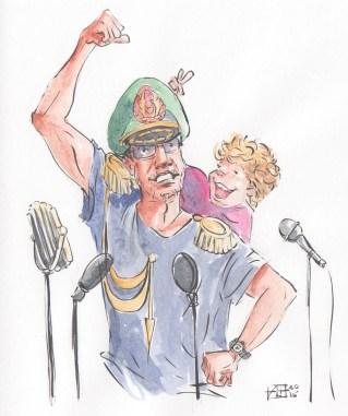 """tata w stroju dyktatora przemawia, a za nim jego synek pokazuje mu palcami """"rogi"""""""