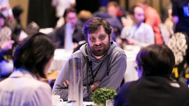 Men talk at a conference
