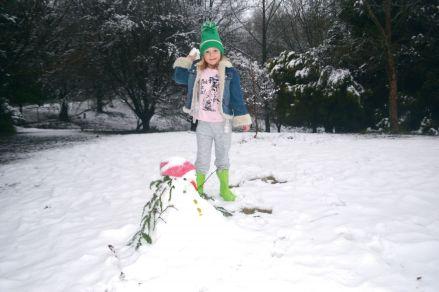 Mali Gwynne (7) is ready for a snow fight.