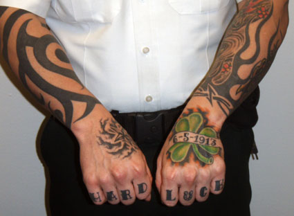 So besides the neck tattoos the deputy also tattooed his knuckles and hands…