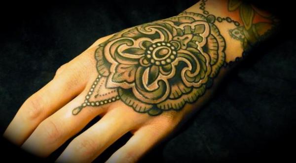 hand geometric tattoo seven