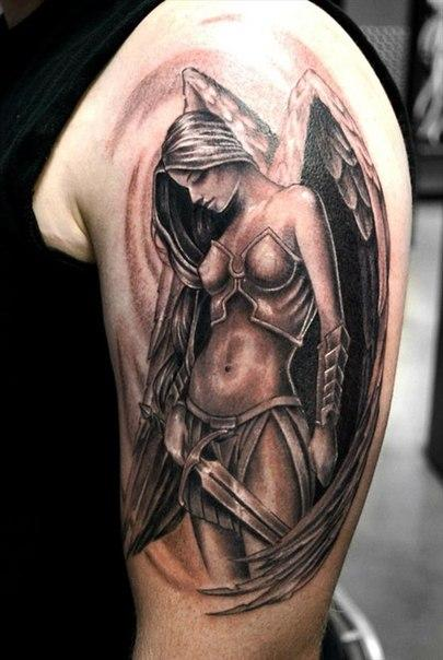 A striking female angel with a sword - a protective tattoo on the forearm