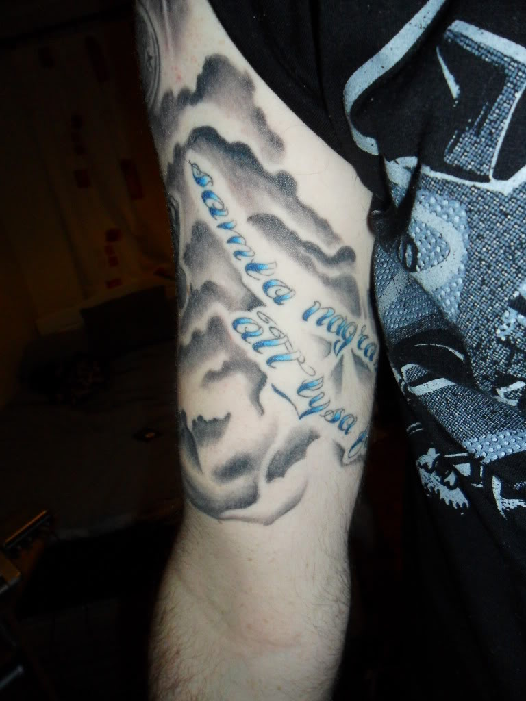 Clouds Chest And Sun Tattoo Rising