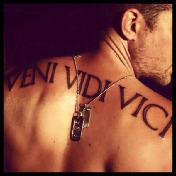 Man veni vidi vici on the upper back tattoo