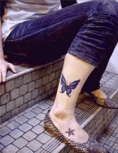 Beautiful butterfly leg tattoo