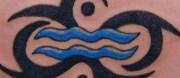 blue ink tribal aquarius tattoo