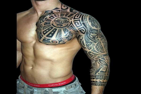 maori chest and sleeve tattoo