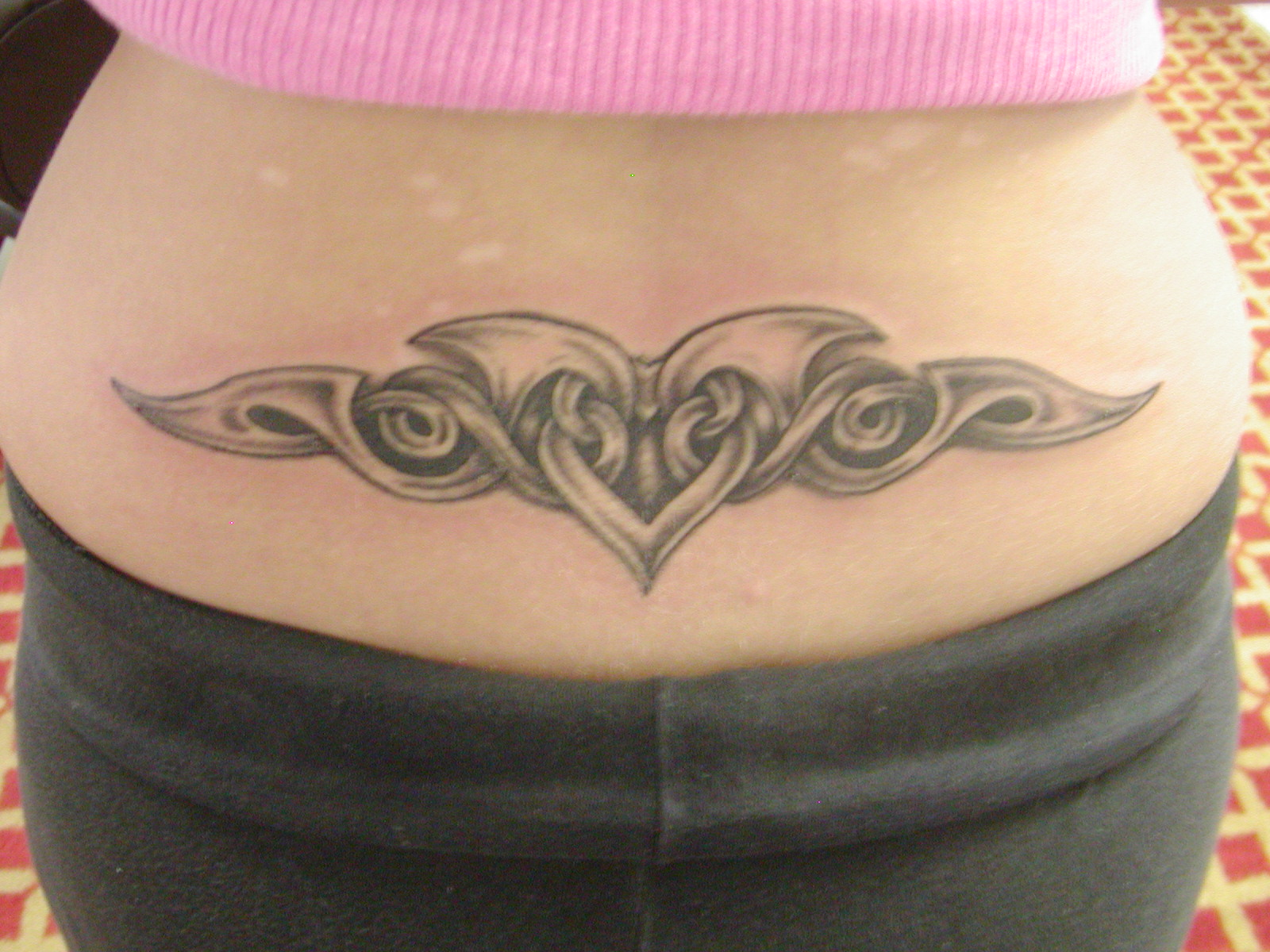 Lower Back Tattoos For Females