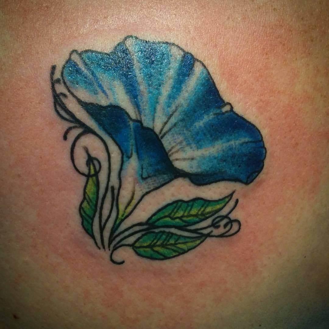 Tattoo kleine blaue Blume