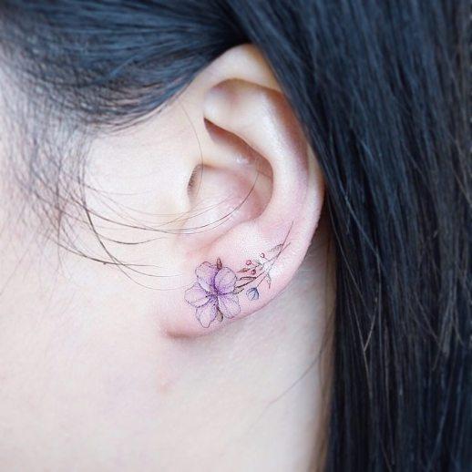 Flor lila por Mini Tattoo