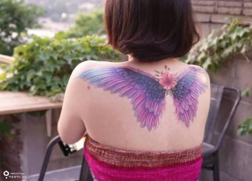 Alas de mariposa por Tattooist Silo