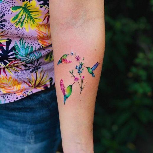 Colibríes revoloteando flores por Claudio Esteban Gajardo Muñoz