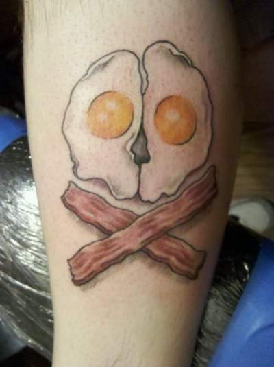 Guy get's his breakfast as a tattoo
