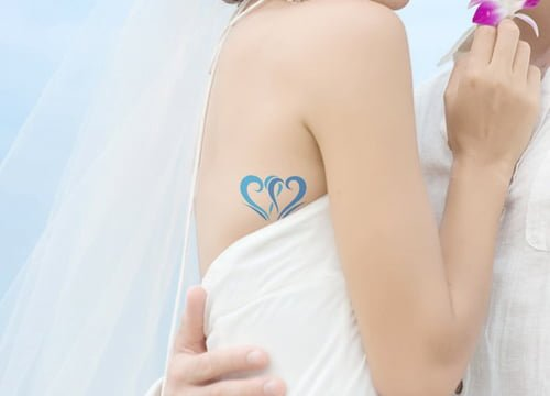 Tatuaje corazones pareja