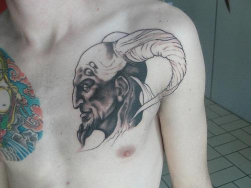 Demon's tattoo on chest