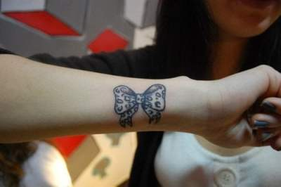 Ribbon tattoo for girl