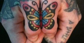 Butterflies thumb tattoos