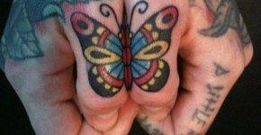 Tatuaje mariposa pulgares