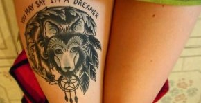 wolf tattoo on the leg