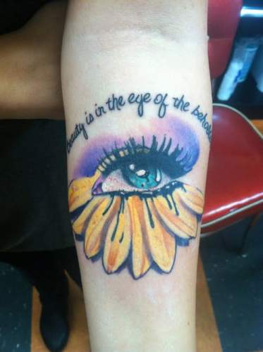 Tatuajes de frases en el brazo