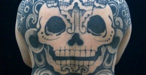 Skull tattoos on the back
