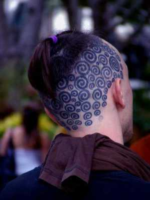 Circle tattoos on head