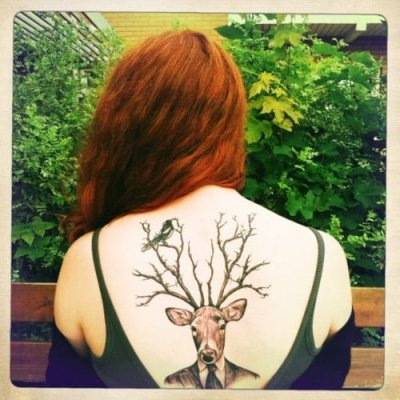 Deer tattoo on the back