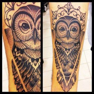 Owl tattoo on the arm