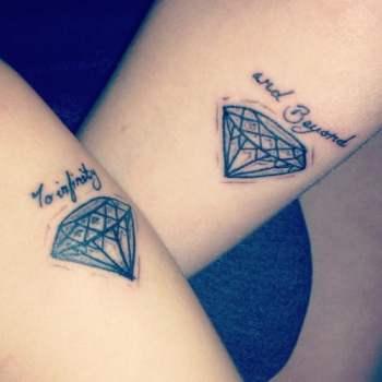 Diamond tattoos on the arms