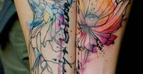 Flower and bird tattooed on arms